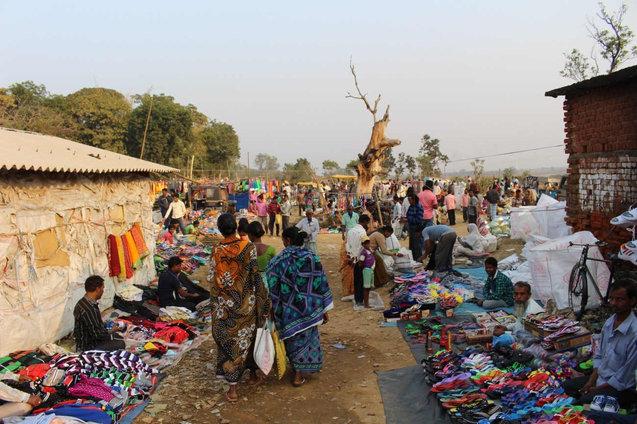 Vendors display their wares at a sprawling village market in the Indian state of Jharkhand. Hawkers from nearby villages bring their wares for a weekly bazaar, where stalls selling everything from T-shirts to potatoes and aluminum pots compete for the attention of shoppers.