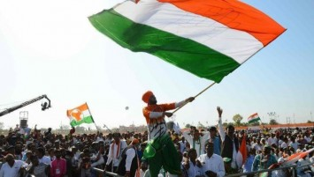 Supporters of India's opposition Congress party cheer at an election rally outside the city of Ahmedabad on March 12.(Sam Panthaky / AFP/Getty Images)