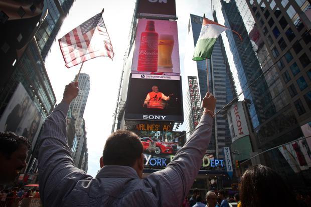Waving both flags (Reuters/Carlo Allegri)