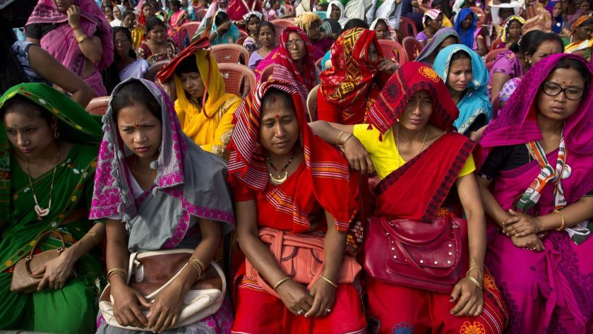 Indian tribal women in traditional attire listen to Congress Party President Rahul Gandhi at a campaign rally in the northeastern state of Assam on April 3, 2019.(Anupam Nath / Associated Press)