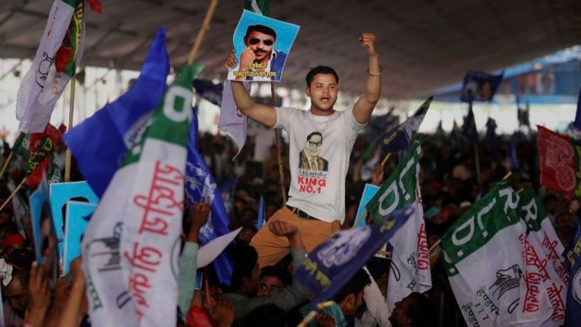 A demonstrator in Uttar Pradesh displays a picture of Dalit leader Chandrasekhar Azad at a rally in Deoband, India, in April.(Altaf Qadri / Associated Press)