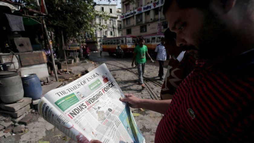 An Indian man reads a Feb. 27 newspaper detailing airstrikes the day before in Pakistan. During India and Pakistan's recent clashes, a deluge of fake news on social media, sometimes picked up by traditional media, fueled calls for escalation. (Piyal Adhikary / EPA/Shutterstock)