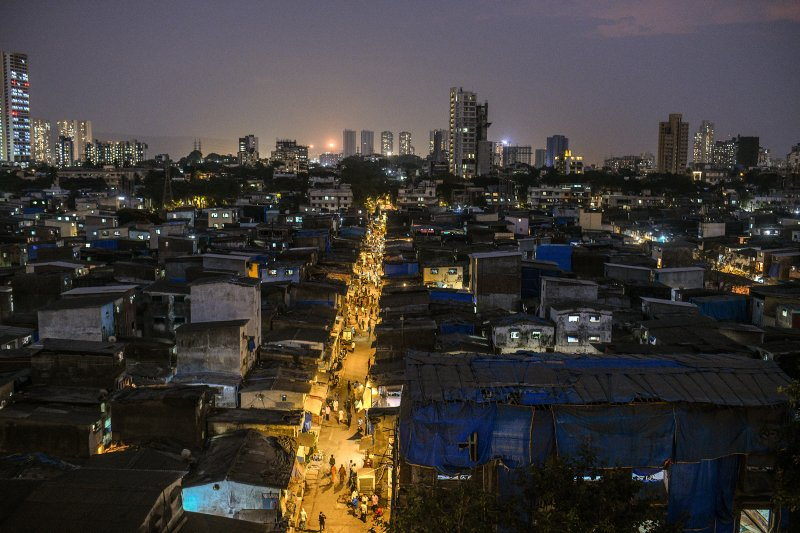 Dharavi in late April. The hyper-dense network of brick homes and small scale enterprises, which sprawl in the shadow of shiny new skyscrapers, was home to a thriving economy—until recently. (Atul Loke—The New York Times/Redux)